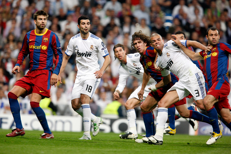 Group of players looking at the ball after a free kick, UEFA Champions League Semifinals game between Real Madrid and FC Barcelona, Bernabeu Stadiumn, Madrid, Spain