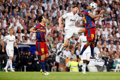 Keita heading the ball before Xavi Alonso, UEFA Champions League Semifinals game between Real Madrid and FC Barcelona, Bernabeu Stadiumn, Madrid, Spain