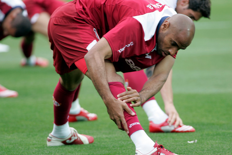 Kanoute and other Sevilla FC fellows stretching  before the local derby between Real Betis and Sevilla FC which took place at Ruiz de Lopera stadium, Seville, Spain, on 11 May 2008.