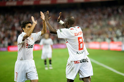 Navas and Zokora encourage each other. Spanish League game between Sevilla FC and Real Madrid, Sanchez Pizjuan Stadium, Seville, Spain, 4 October 2009