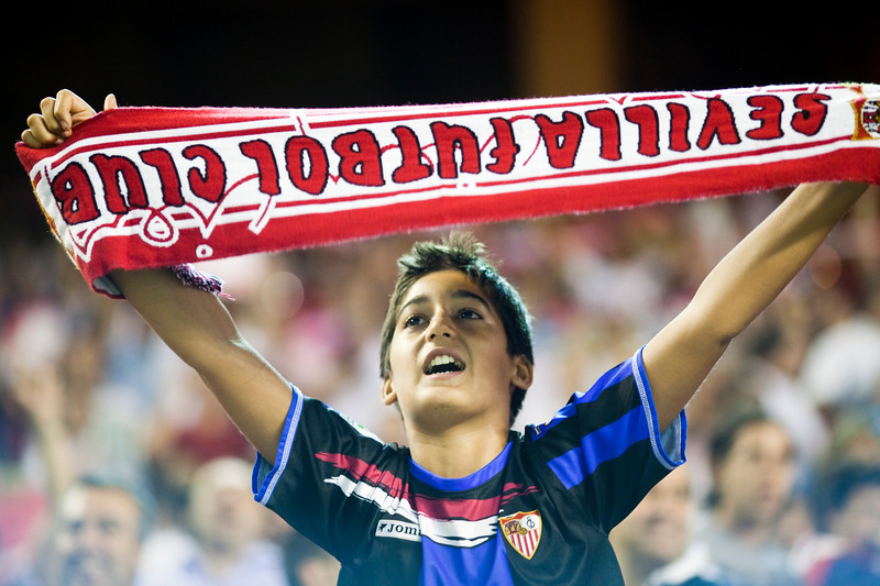 Young Sevilla FC fan with a scarf. Spanish League game between Sevilla FC and Real Madrid, Sanchez Pizjuan Stadium, Seville, Spain, 4 October 2009