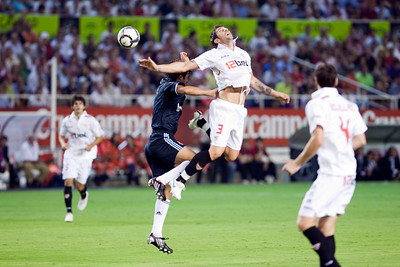 Raul and Dragutinovic jumping. Spanish League game between Sevilla FC and Real Madrid, Sanchez Pizjuan Stadium, Seville, Spain, 4 October 2009
