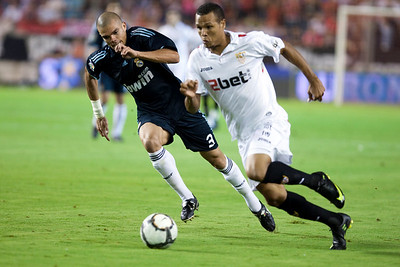 Luis Fabiano pursued by Pepe. Spanish League game between Sevilla FC and Real Madrid, Sanchez Pizjuan Stadium, Seville, Spain, 4 October 2009