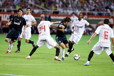 Raul surrounded by opponent players. Spanish League game between Sevilla FC and Real Madrid, Sanchez Pizjuan Stadium, Seville, Spain, 4 October 2009