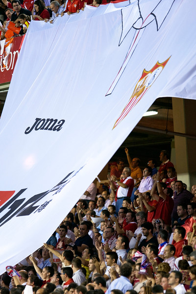 Sevilla FC fans doing a tifo with a gigantic shirt. Taken before the Spanish League game between Sevilla FC and Real Madrid, Sanchez Pizjuan Stadium, Seville, Spain, 4 October 2009