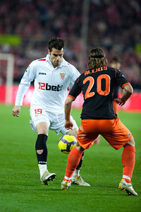 Negredo marked by Alexis. Spanish Liga game between Sevilla FC and Valencia CF. Sanchez Pizjuan stadium, Seville, Spain, 31 January 2010