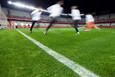 Football players training by night. Sanchez Pizjuan stadium, Seville, Spain.