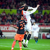 David Navarro and Negredo jumping. Spanish Liga game between Sevilla FC and Valencia CF. Sanchez Pizjuan stadium, Seville, Spain, 31 January 2010
