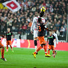 Negredo and Miguel jumping for the ball. Spanish Liga game between Sevilla FC and Valencia CF. Sanchez Pizjuan stadium, Seville, Spain, 31 January 2010