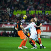 Kanoute fighting for the ball between Albelda (left) and David Navarro. Spanish Liga game between Sevilla FC and Valencia CF. Sanchez Pizjuan stadium, Seville, Spain, 31 January 2010