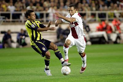 Gökçek Vederson (Fenerbahçe) committing foul on Luis Fabiano (Sevilla). UEFA Champions League first knockout round game (second leg) between Sevilla FC (Seville, Spain) and Fenerbahce (Istambul, Turkey), Sanchez Pizjuan stadium, Seville, Spain, 04 March 2008.