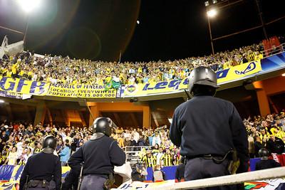 Spanish riot policemen watching Turkish fans. UEFA Champions League first knockout round game (second leg) between Sevilla FC (Seville, Spain) and Fenerbahce (Istambul, Turkey), Sanchez Pizjuan stadium, Seville, Spain, 04 March 2008.