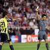 Selçuk Şahin (Fenerbahçe) being shown a yellow card by the Swiss referee Massimo Busacca. UEFA Champions League first knockout round game (second leg) between Sevilla FC (Seville, Spain) and Fenerbahce (Istambul, Turkey), Sanchez Pizjuan stadium, Seville, Spain, 04 March 2008.