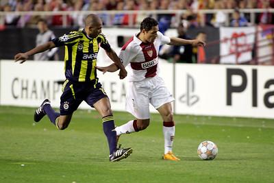 Mehmet Aurélio (Fenerbahçe) trying to stop Adriano (Sevilla). UEFA Champions League first knockout round game (second leg) between Sevilla FC (Seville, Spain) and Fenerbahce (Istambul, Turkey), Sanchez Pizjuan stadium, Seville, Spain, 04 March 2008.