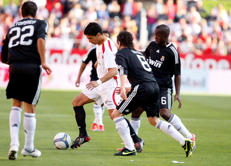 Renato (Sevilla) surrounded by Real Madrid's Torres (left), Gago (center) and Lass (right). Spanish Liga football game between Sevilla FC and Real Madrid CF that took place at Sanchez Pizjuan stadium, Seville, Spain, on 26 April 2009