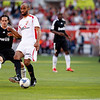 Kanoute kicking the ball before Fernando Gago. Spanish Liga football game between Sevilla FC and Real Madrid CF that took place at Sanchez Pizjuan stadium, Seville, Spain, on 26 April 2009