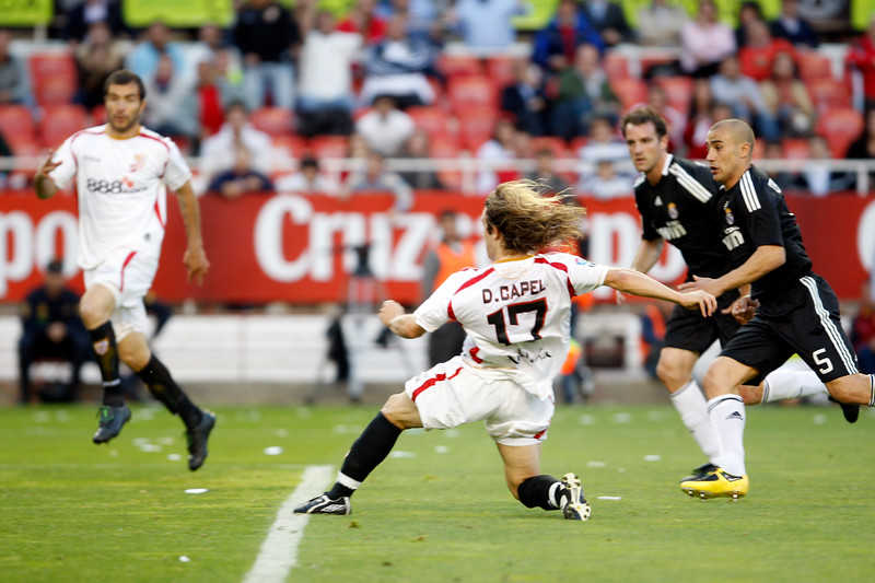Diego Capel (Sevilla) scoring a goal before Cannavaro and Metzelder (back). Spanish Liga football game between Sevilla FC and Real Madrid CF that took place at Sanchez Pizjuan stadium, Seville, Spain, on 26 April 2009
