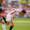 Jesus Navas (Sevilla) struggling with Miguel Torres (Real Madrid). Spanish Liga football game between Sevilla FC and Real Madrid CF that took place at Sanchez Pizjuan stadium, Seville, Spain, on 26 April 2009