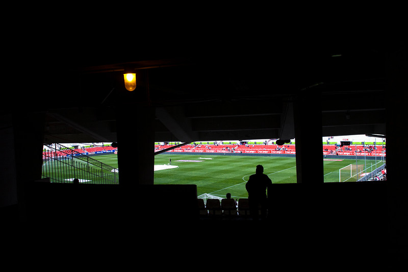 Silhouette of a man looking at a football pitch. Taken before the Spanish Liga football game between Sevilla FC and Real Madrid CF that took place at Sanchez Pizjuan stadium, Seville, Spain, on 26 April 2009