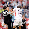 Real Madrid goalkeeper, Iker Casillas, clearing the ball between his fellow Higuain (20) and Sevilla's Escude (14). Spanish Liga football game between Sevilla FC and Real Madrid CF that took place at Sanchez Pizjuan stadium, Seville, Spain, on 26 April 2009