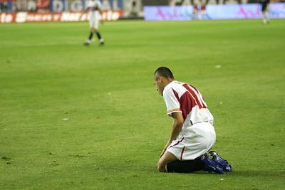 Adriano kneeling