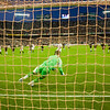 Kanoute performing a penalty