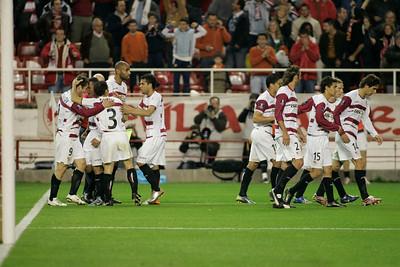 Sevilla FC players celebrating a goal