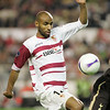 Kanoute fighting for the ball