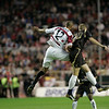 Kanoute and Dawson in aerial action