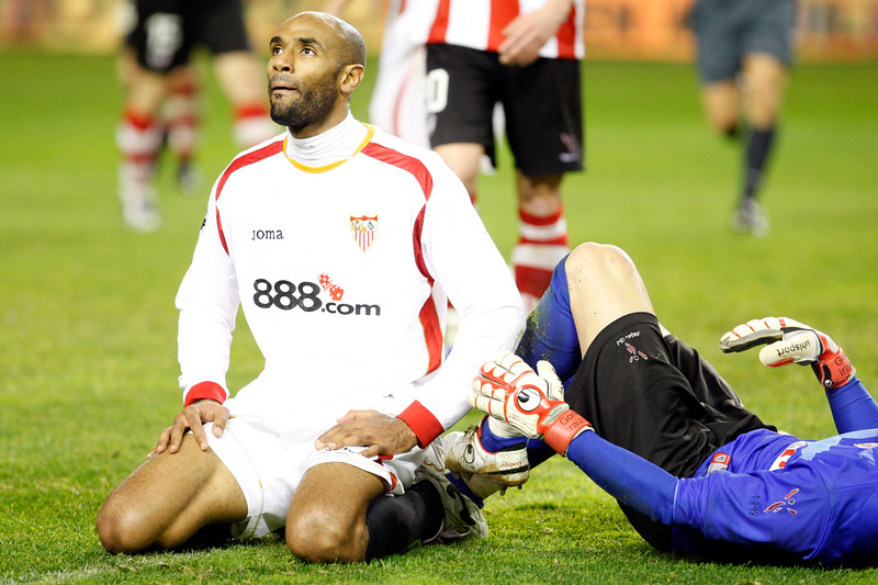 Kanoute (Sevilla FC) moaning after failing a goal chance. Taken in the Sanchez Pizjuan stadium on 4 Feb 2009 during the King's Cup semifinal game between the football teams Sevilla FC and Athletic Club of Bilbao, town of Seville, autonomous community of Andalusia, southern Spain