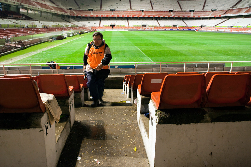Journalist leaving the empty stadium. Taken in the Sanchez Pizjuan stadium on 4 Feb 2009 after the King's Cup semifinal game between the football teams Sevilla FC and Athletic Club of Bilbao, town of Seville, autonomous community of Andalusia, southern Spain