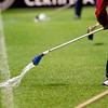Sevilla FC employees trying to take the water out of the field before the game. Taken in the Sanchez Pizjuan stadium on 4 Feb 2009 during the King's Cup semifinal game between the football teams Sevilla FC and Athletic Club of Bilbao, town of Seville, autonomous community of Andalusia, southern Spain