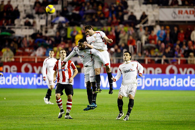Fernando Navarro (Sevilla) heading the ball. taken in the Sanchez Pizjuan stadium on 4 Feb 2009 during the King's Cup semifinal game between the football teams Sevilla FC and Athletic Club of Bilbao, town of Seville, autonomous community of Andalusia, southern Spain