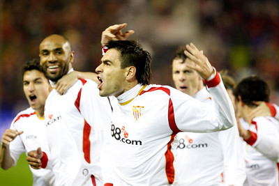 Navas, Kanoute, Duscher and Squilachi (left to right) celebrating a Sevilla FC goal. Taken in the Sanchez Pizjuan stadium on 4 Feb 2009 during the King's Cup semifinal game between the football teams Sevilla FC and Athletic Club of Bilbao, town of Seville, autonomous community of Andalusia, southern Spain