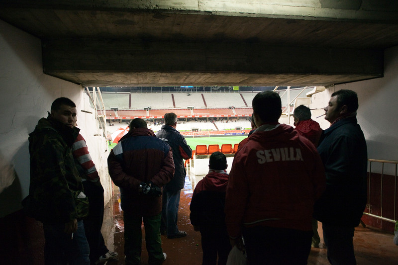 Football fans sheltering from the rain. Taken in the Sanchez Pizjuan stadium on 4 Feb 2009 during the King's Cup semifinal game between the football teams Sevilla FC and Athletic Club of Bilbao, town of Seville, autonomous community of Andalusia, southern Spain