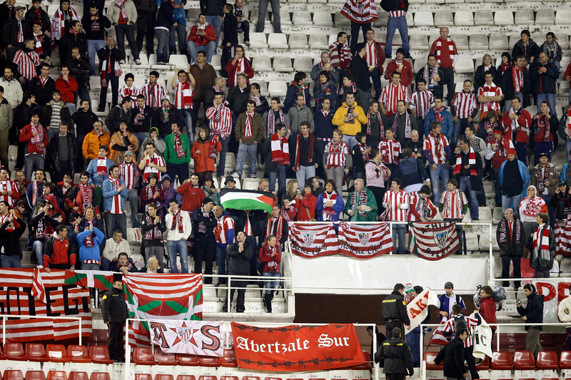 Fans of the Basque team Athlectic of Bilbao. Taken in the Sanchez Pizjuan stadium on 4 Feb 2009 during the King's Cup semifinal game between the football teams Sevilla FC and Athletic Club of Bilbao, town of Seville, autonomous community of Andalusia, southern Spain
