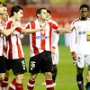 Athletic Club players (Aitor Ocio, Iraola and Orbaiz, left to right) trying to avoid a yellow card while Romaric (Sevilla) looks at the scene. Taken in the Sanchez Pizjuan stadium on 4 Feb 2009 during the King's Cup semifinal game between the football teams Sevilla FC and Athletic Club of Bilbao, town of Seville, autonomous community of Andalusia, southern Spain