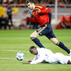 Pique (Spain) and Emile Heskey (England, on the ground). Taken during the friendly football game between the national teams of Spain and England that took place in the Sanchez Pizjuan stadium, Seville, Spain, 11 Feb 2009.