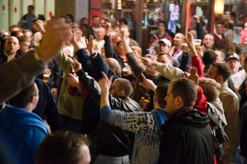 English fans drinking and singing near the stadium. Taken before the friendly football game between the national teams of Spain and England that took place in the Sanchez Pizjuan stadium, Seville, Spain, 11 Feb 2009.