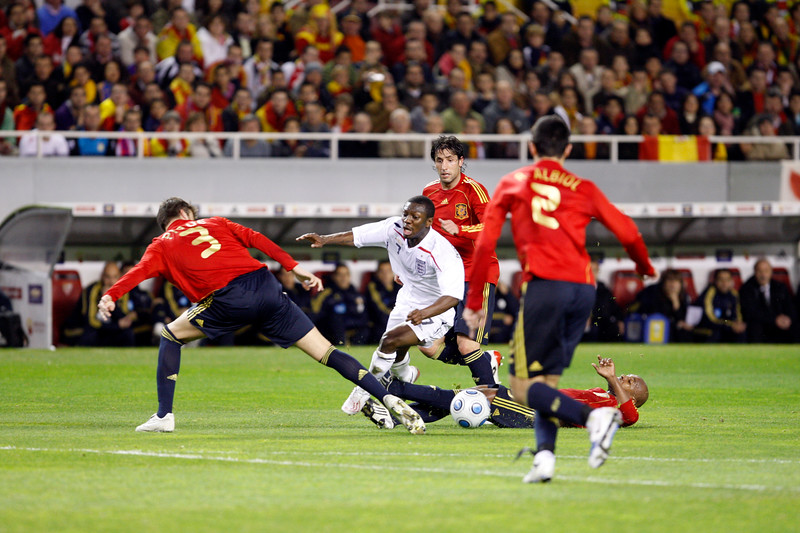 Wright-Phillips (England) surrounded by Spanish players. Taken during the friendly football game between the national teams of Spain and England that took place in the Sanchez Pizjuan stadium, Seville, Spain, 11 Feb 2009.