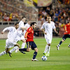 Xavi (Spain) with the ball pursued by Ashley Cole. Taken during the friendly football game between the national teams of Spain and England that took place in the Sanchez Pizjuan stadium, Seville, Spain, 11 Feb 2009.