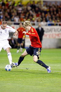 Fernando Torres struggling with Matthew Upson. Taken during the friendly football game between the national teams of Spain and England that took place in the Sanchez Pizjuan stadium, Seville, Spain, 11 Feb 2009.