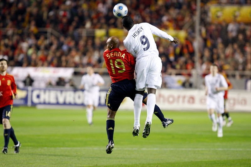 Senna (Spain) and Emile Heskey (England) jumping for the ball. Taken during the friendly football game between the national teams of Spain and England that took place in the Sanchez Pizjuan stadium, Seville, Spain, 11 Feb 2009.