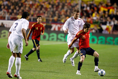 Silva marked by Beckham. Taken during the friendly football game between the national teams of Spain and England that took place in the Sanchez Pizjuan stadium, Seville, Spain, 11 Feb 2009.