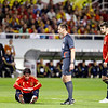 Joan Capdevilla sitting on the grass before the referee and Pique. Taken during the friendly football game between the national teams of Spain and England that took place in the Sanchez Pizjuan stadium, Seville, Spain, 11 Feb 2009.