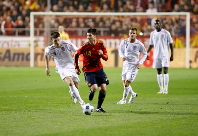 Xabi Alonso pursued by Michael Carrick. Taken during the friendly football game between the national teams of Spain and England that took place in the Sanchez Pizjuan stadium, Seville, Spain, 11 Feb 2009.