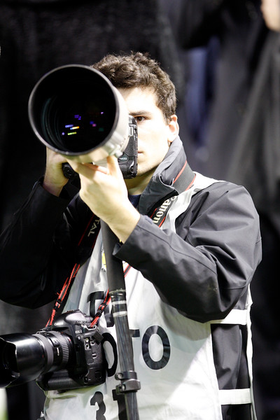 Sport photographer at work. Taken during the friendly football game between the national teams of Spain and England that took place in the Sanchez Pizjuan stadium, Seville, Spain, 11 Feb 2009.