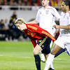 Fernando Torres between Johnson (foreground) and Upson (background). Taken during the friendly football game between the national teams of Spain and England that took place in the Sanchez Pizjuan stadium, Seville, Spain, 11 Feb 2009.