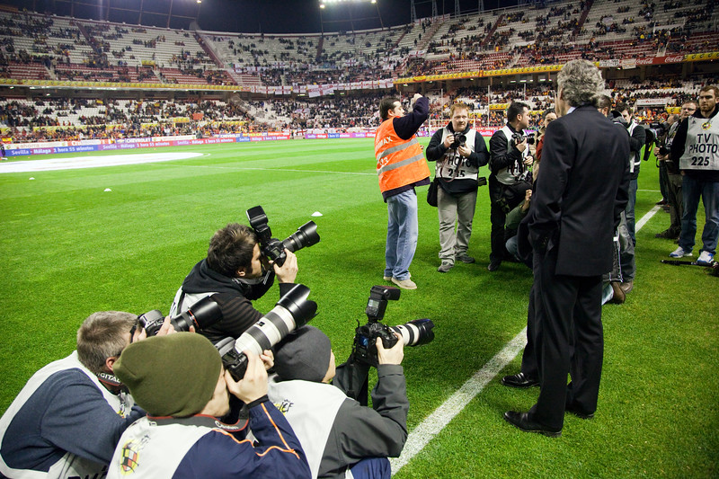 Photographers taking pictures of Franco Baldini and Fabio Capello (hidden). Taken before the friendly football game between the national teams of Spain and England that took place in the Sanchez Pizjuan stadium, Seville, Spain, 11 Feb 2009.