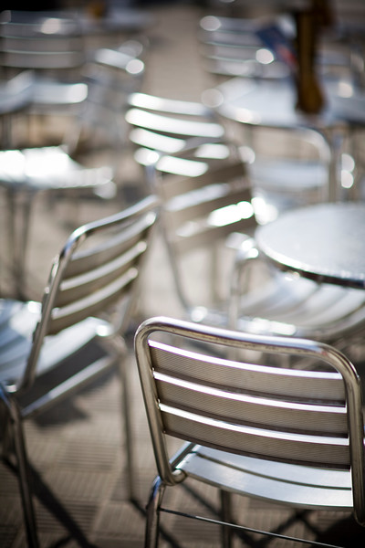 Metallic seats and tables of an outdoor restaurant, Seville, Spain